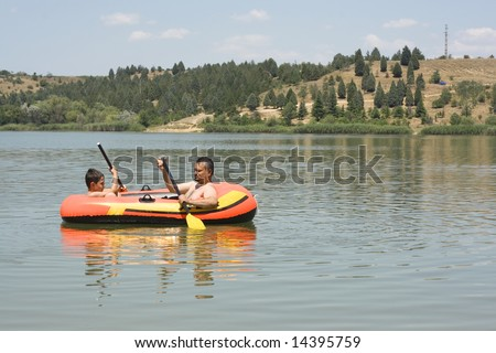 Father and son in the boat - stock photo