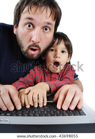 Father and son on laptop, shock - stock photo