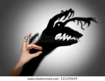 Fear, fright, shadow on the wall - stock photo