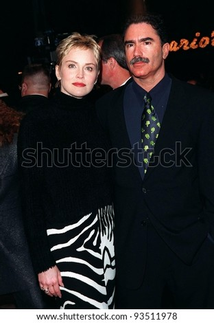 """11FEB98:  Actress SHARON STONE & fiance PHIL BRONSTEIN at premiere of her new movie, """"Sphere"""" in which she stars with Dustin Hoffman & Samuel L. Jackson. - stock photo"""