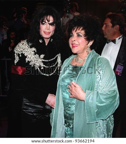 16FEB97:  ELIZABETH TAYLOR & MICHAEL JACKSON arriving at the Pantages Theatre, Hollywood, for her birthday celebration gala.    Pix: PAUL SMITH - stock photo