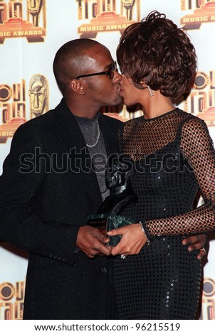 27FEB98: Singer WHITNEY HOUSTON & husband BOBBY BROWN at the Soul Train Awards where she was presented with the 1998 Quincy Jones Award for Career Achievement. Picture: Paul Smith / Featureflash - stock photo