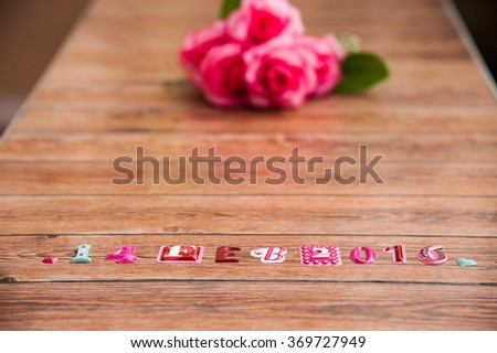 14 February 2016 Happy Valentines Day, Special day, Birthday, Anniversary. Roses and date on wood background, center of frame.Bouquet for special person. - stock photo