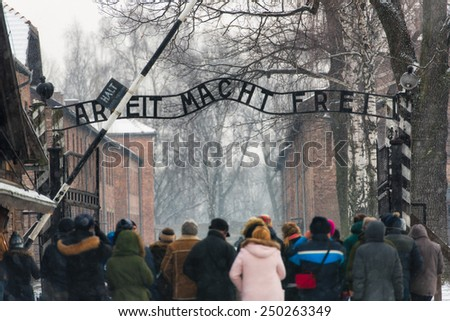 "5 February 2015:  Nazi concentration camp of Auschwitz - Oswiecim, Poland. Visitors entrance under the famous words: ""arbeit macht frei"" (work sets you free)"
