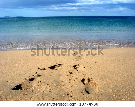 Feet on the beach - stock photo