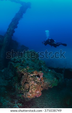 100 feet underwater. Actual underwater photo of Ha-Go Japanese tank on the deck of wreck ship Nippo Maru in Micronesia. Depth 30 meters.This ship become a home for many fishes and corals since 1942. - stock photo