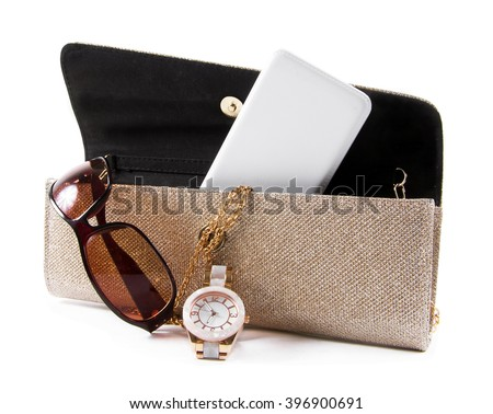 female bag with phone,sunglasses and watch - stock photo
