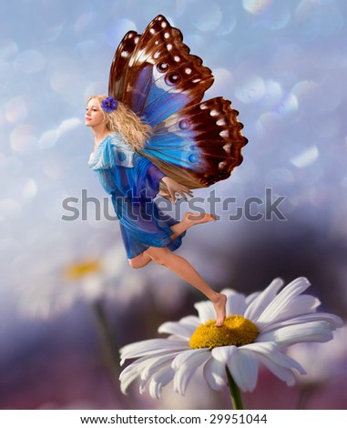 Female Elf fly with chamomile flower - stock photo