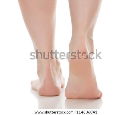 Female feet isolated on white background - stock photo