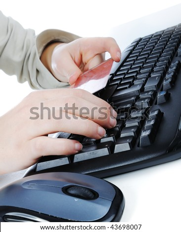 Female hands typing on credit card - stock photo