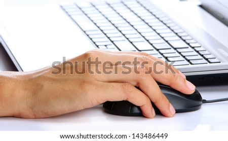 female hands using a computer on office background - stock photo