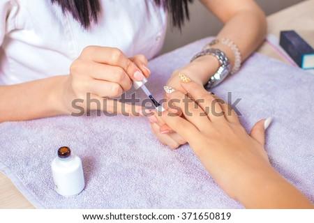 Female nails manicure.     - stock photo