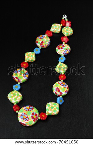 female ornaments from polymeric hand worked clay - stock photo