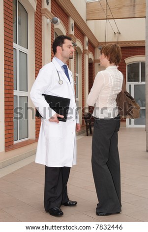 female patient male doctor conversation - stock photo