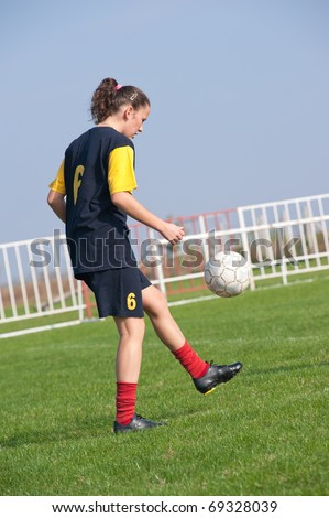 Female soccer player juggling the ball - stock photo