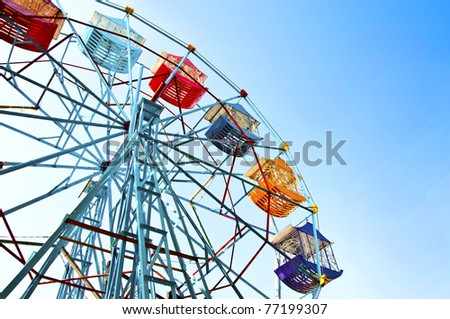 Ferris wheel against the blue sky - stock photo