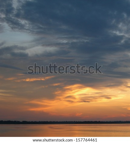 Fiery sunset and sky over the Rio Negro in the Amazon River basin, Brazil, South America       - stock photo