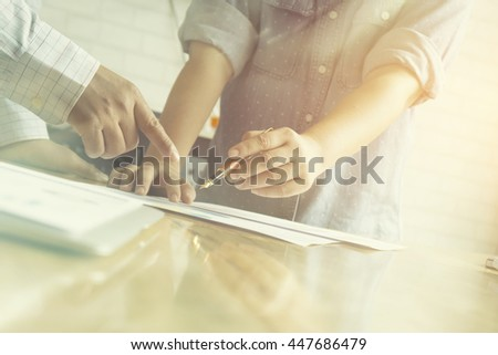 Finance & Business,Team work.young business crew working with new startup project laptop. Project managers meeting and Analyze plans, papers,documents on office table ,vintage color,selective focus - stock photo