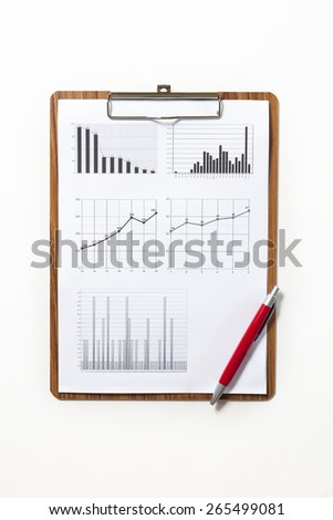 financial growth chart graph on clipboard paper with red pen - stock photo