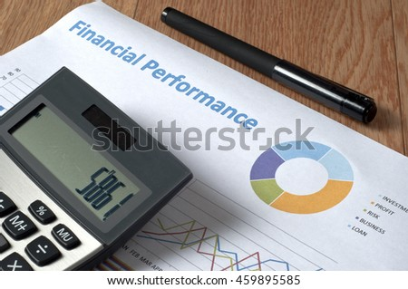 """Financial Performance "" text on paper, pen, cups and calculator on wooden table - business, banking, finance and investment concept"