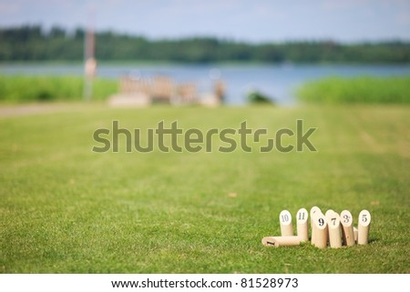 Finnish traditional game wooden pins on field