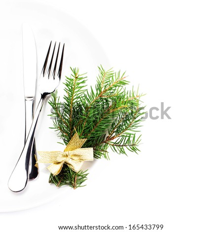 Fir Tree Branch and Christmas table place setting with christmas ornaments on white plate  isolated on white background, top shot. - stock photo