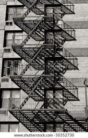 Fire escape on an old building in Manhattan - stock photo