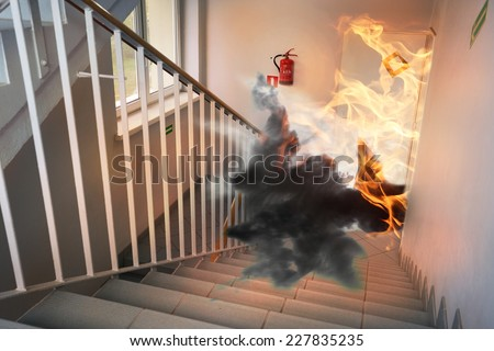 Fire in building - emergency exit - stock photo