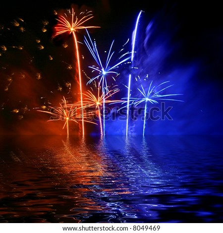 Firework reflection in water - stock photo