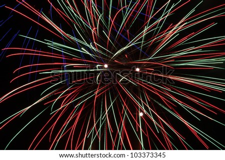 Fireworks in front of black background - stock photo