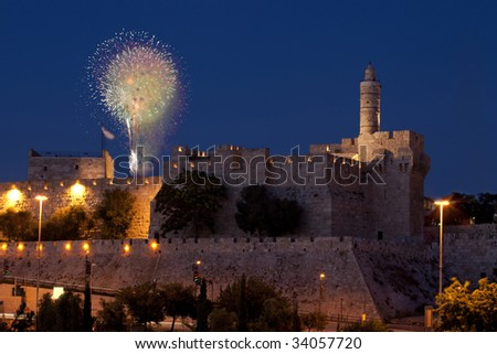 Fireworks in the Old City of David in Jerusalem during the night. - stock photo