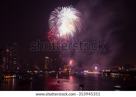 fireworks with city scape night light new year reflections on the river at bangkok city countdown soft focus, bangkok new year countdown