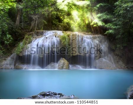 First level of Erawan Waterfall in Kanchanaburi Province, Thailand - stock photo