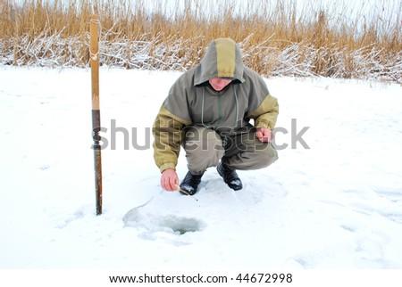 Fisherman enjoying a day on the ice - stock photo