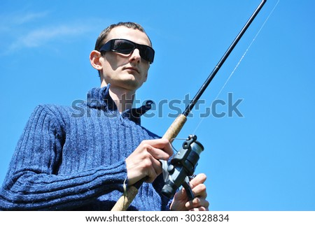 Fisherman  on the river - stock photo
