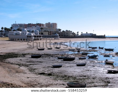 Fishing boats on the beach coast of Cadiz, Andalucia. Spain