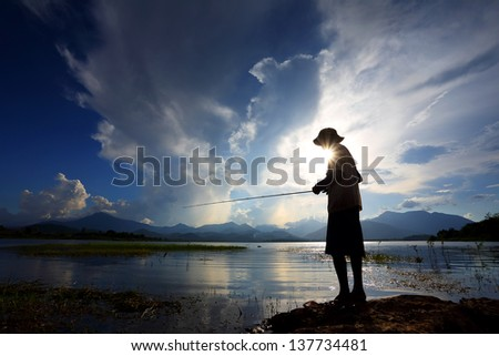 fishing in a lake background natural mountain - stock photo