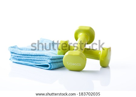 fitness dumbbells and towels - stock photo