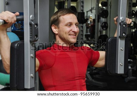 fitness men exercising in the gym