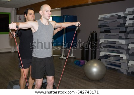 fitness training man exercises at gym with sport  coach