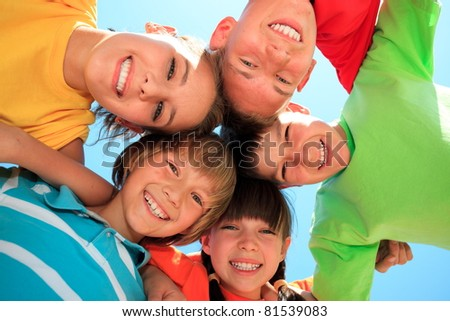 Five happy kids in circle - stock photo