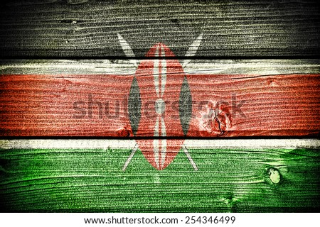 flag of Kenya painted on old grungy wooden  background - stock photo