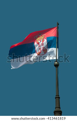 Flag of Serbia  waving in the wind - stock photo
