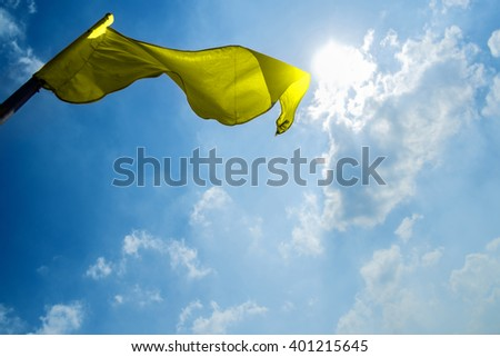 flag on a background of the dark blue sky with clouds. - stock photo