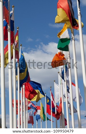 Flags of the different countries on a background of the blue sky - stock photo