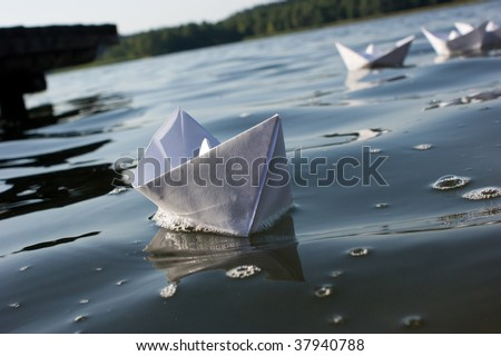fleet of origami handmade paper boats