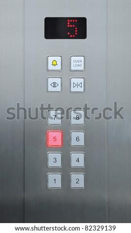 5 floor on elevator buttons - stock photo