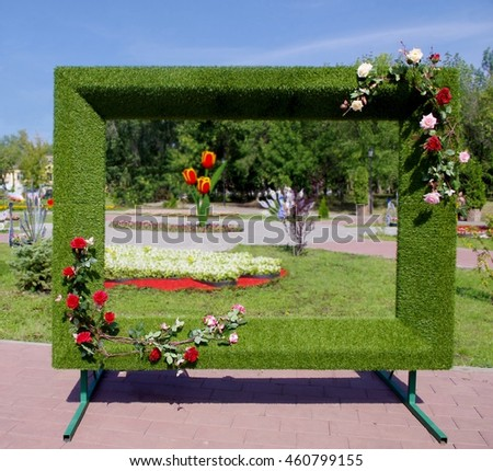floral frame for photos in the city park