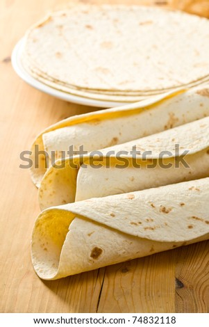 flour tortillas on wooden table - stock photo