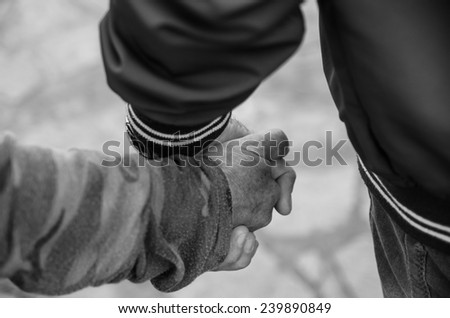 """follow me"" a pair of seniors in love walk hand in hand showing their love - stock photo"